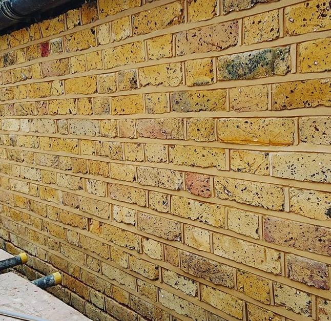 A brick wall  Description automatically generated