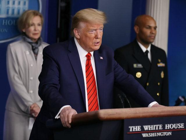 Flanked by members of the Coronavirus Task Force, U.S. President Donald Trump speaks during a news briefing on the latest development of the coronavirus outbreak in the U.S. in the James Brady Press Briefing Room at the White House March 19, 2020 in Washington, DC. With Americans testing positive by …