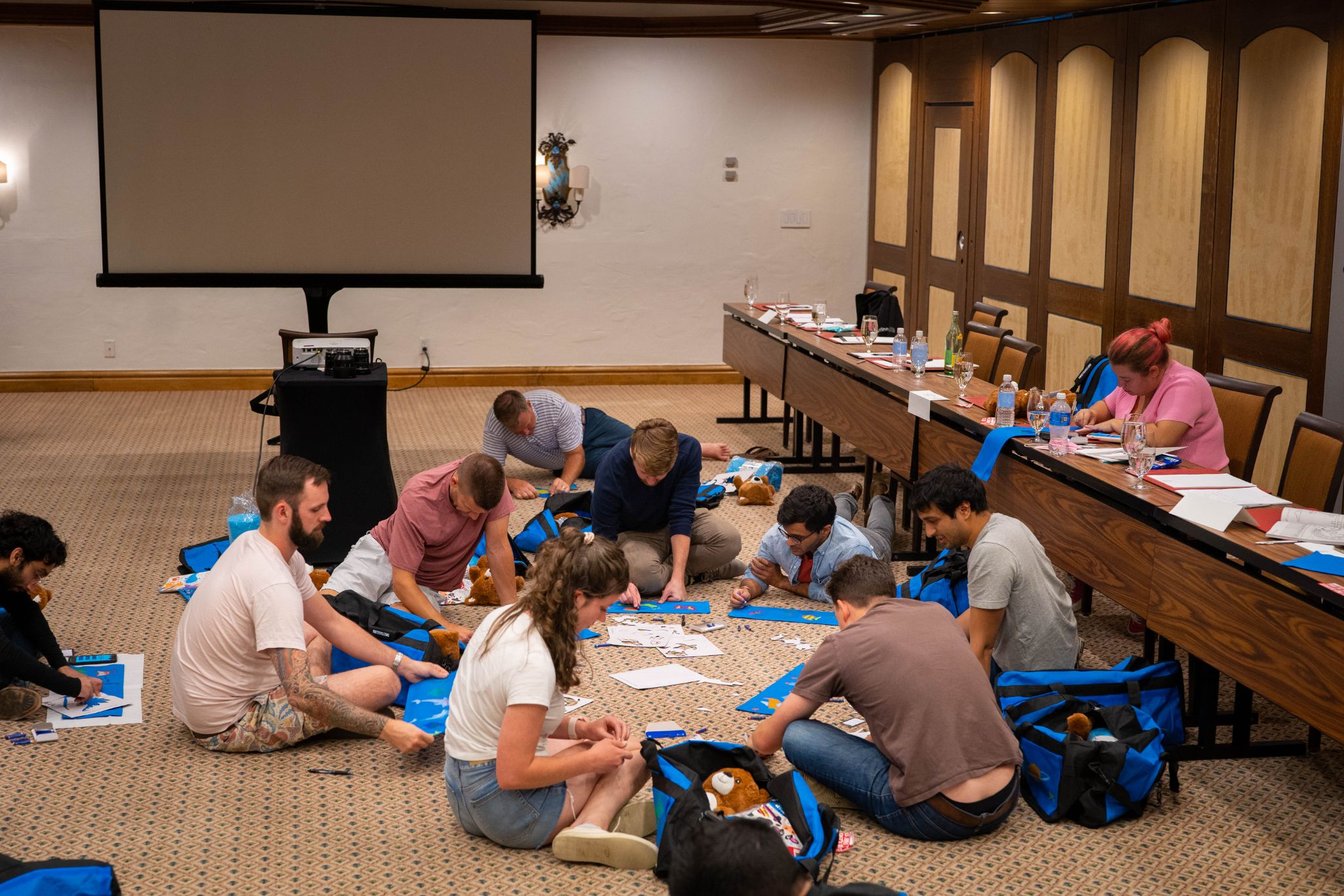 Group of people assembling care packages_pathpoint corporate retreat_flok