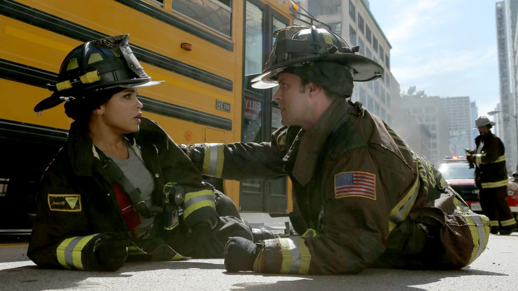 Two of the characters from the series 'Chicago Fire' have a caring moment. He places his hand on her arm.