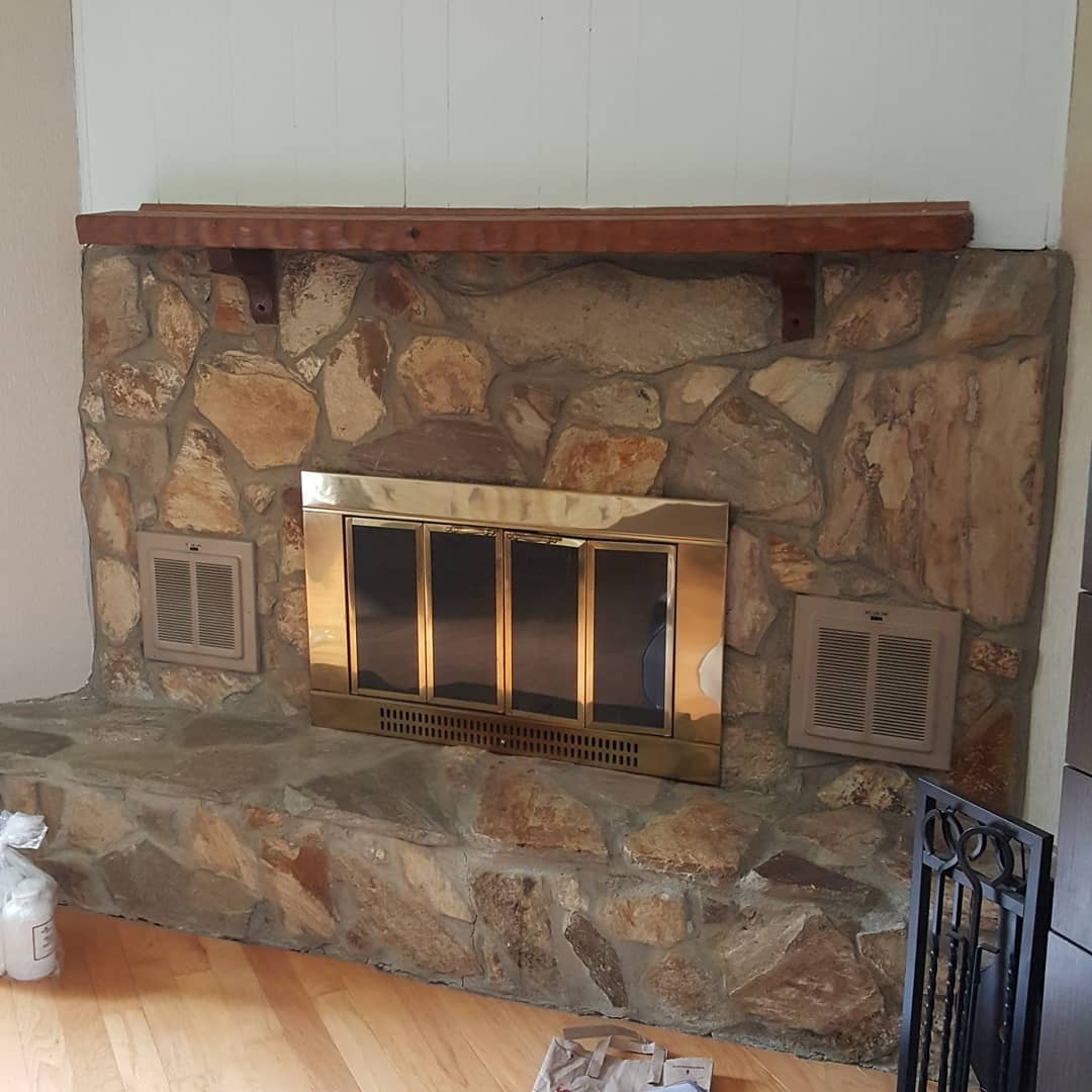 stone fireplace before painting
