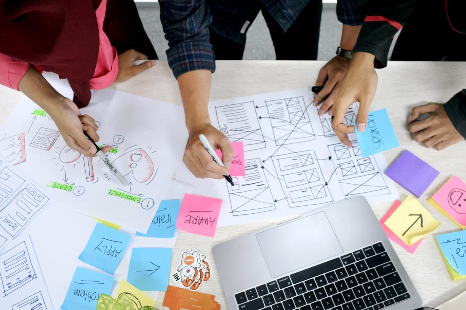 A team of designers and developers working on a user experience tasks.