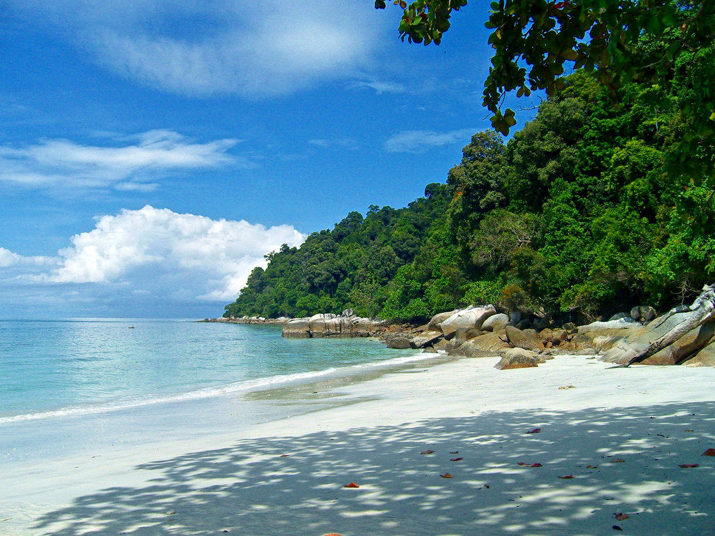 The soft white sand and clear blue waters at Pangkor Island.