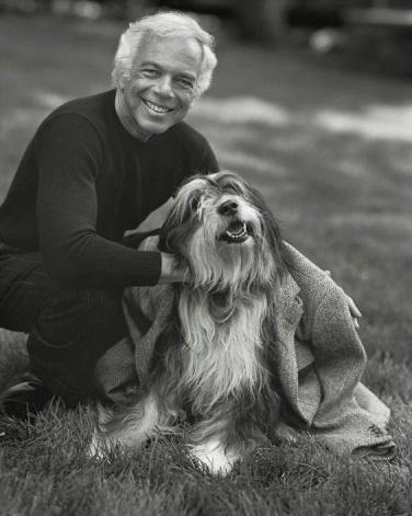 A person holding a dog</div><div class=