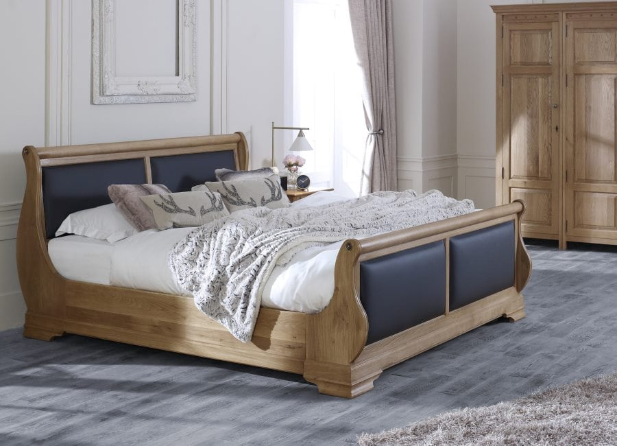 The Tuscany Sleigh Bed in Natural Oak with Black leather