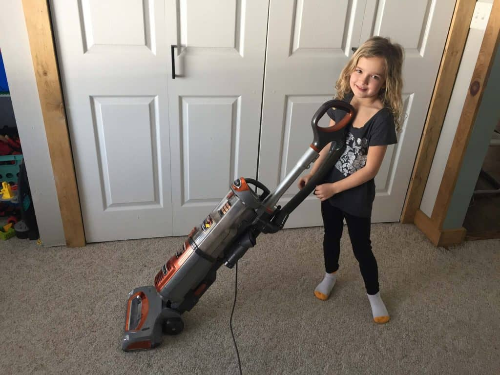 Age appropriate chores for 5-6 year olds: Photo of a 5-6 year old vacuuming