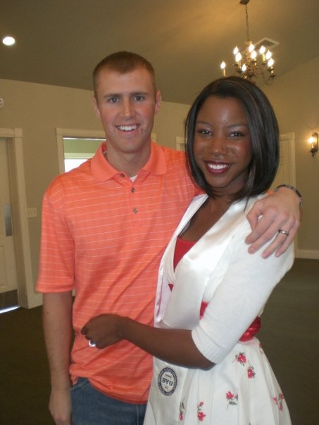 Interracial couple at college graduation. How to avoid college debt.