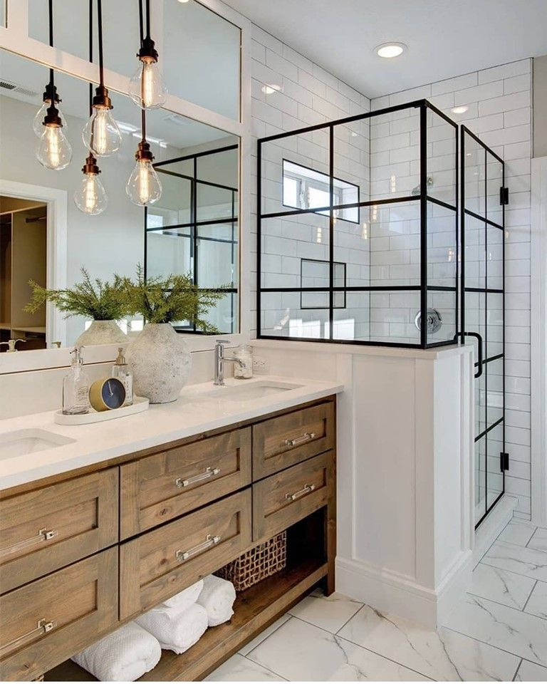 modern bathroom with natural wood shaker cabinets, black framed shower door, white subway tile backsplash and white tile floors