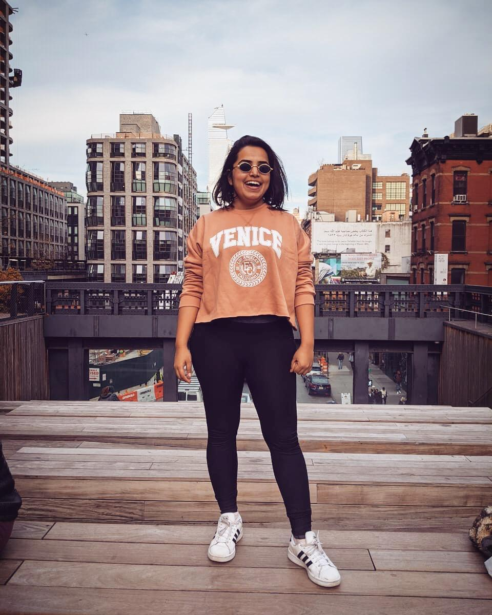 Picture of host Momina Mindeel standing on the High Line.
