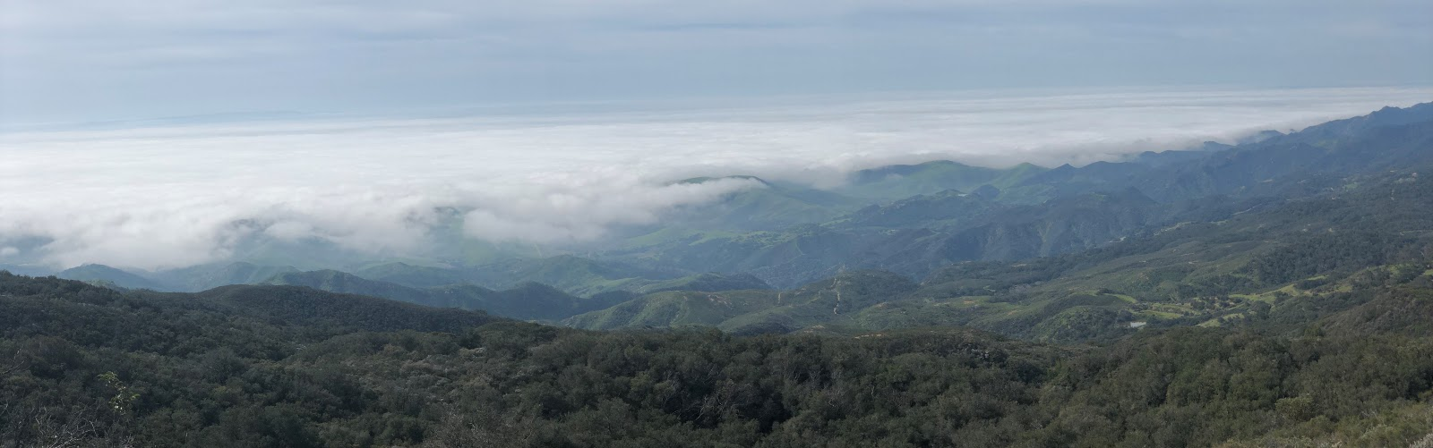 Cycling Refugio Road - aerial drone photo of clouds and hillside