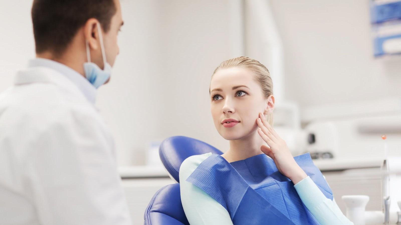 C:\Users\PC\Downloads\woman-in-a-dentist-office.jpg