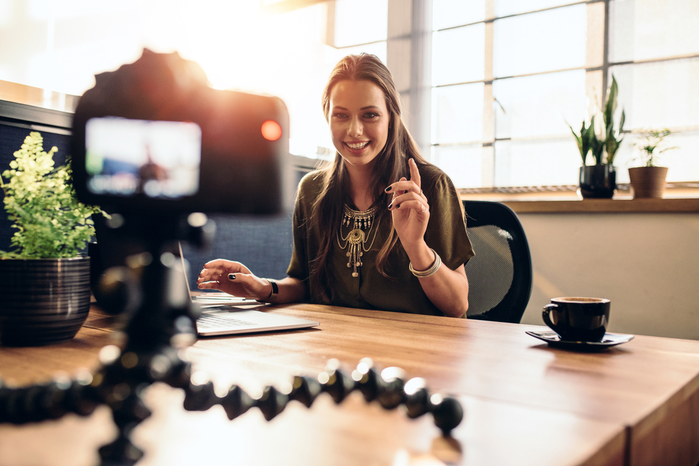 Woman shooting a small business marketing video from her desk
