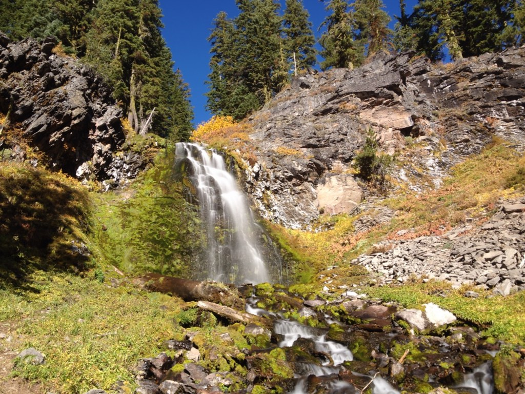 Plaikni Falls falling over down the hillside and sheer rocks in Crater Lake National Park on the Waterfall Road Trip near Klamath Falls.