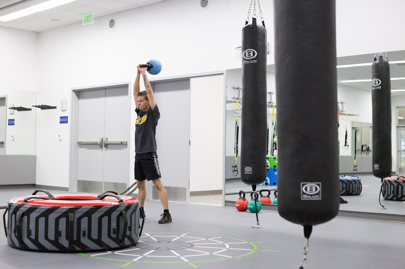 A young man works out in Studio B