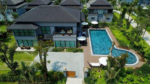 Bird's Eye View of a House with Swimming Pool