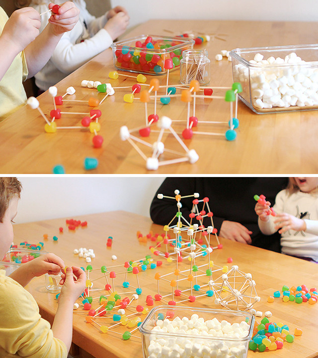 Children creating structures with toothpicks, gumdrops, and mini marshmallows