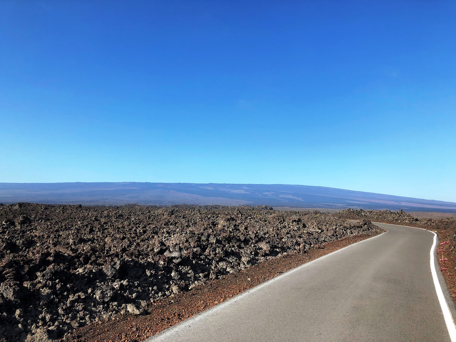 View of Mauna Loa shield volcano from distance