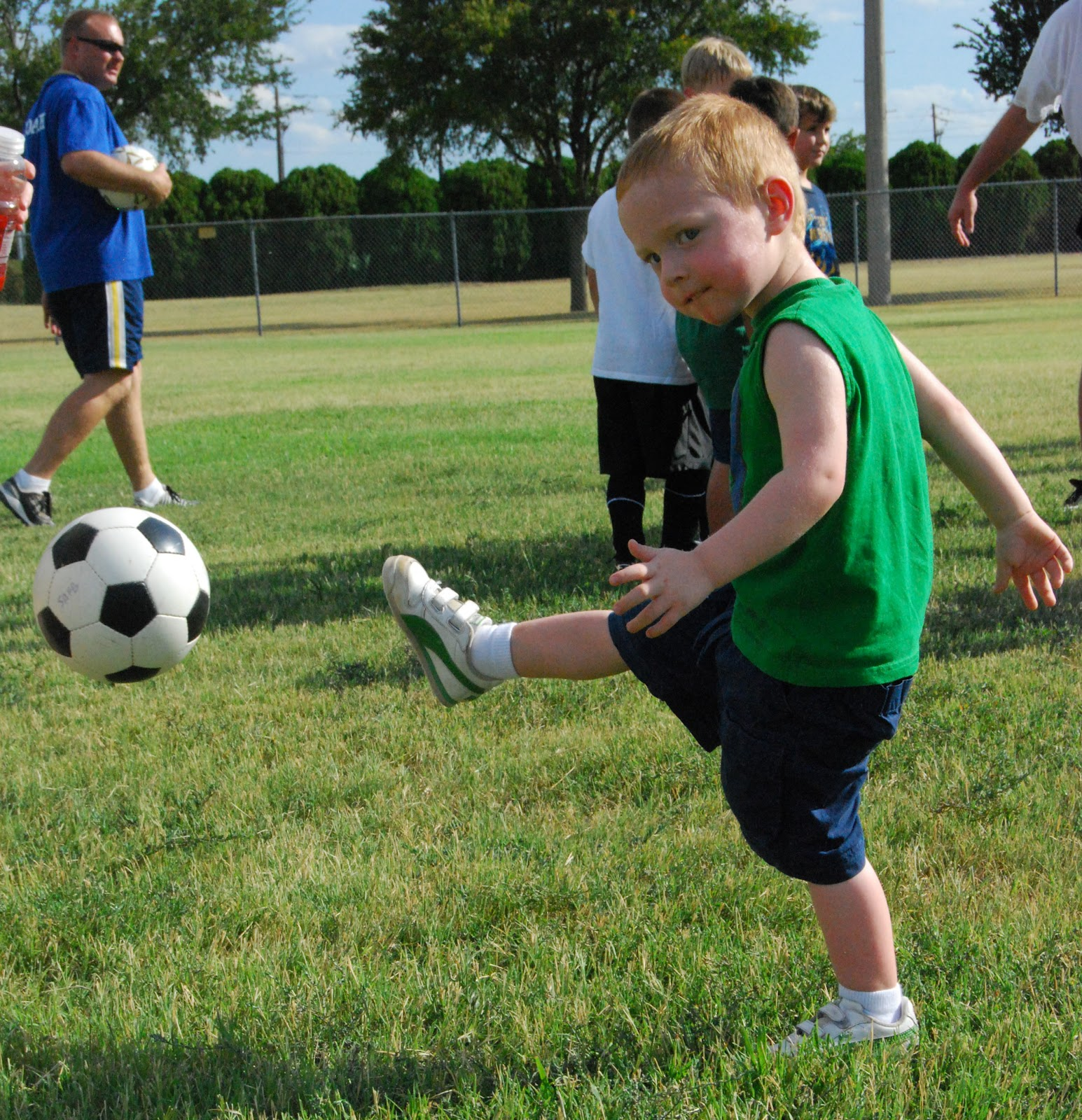 Kid kicking a soccer ball (Soccer for 3 and 4-year-olds)