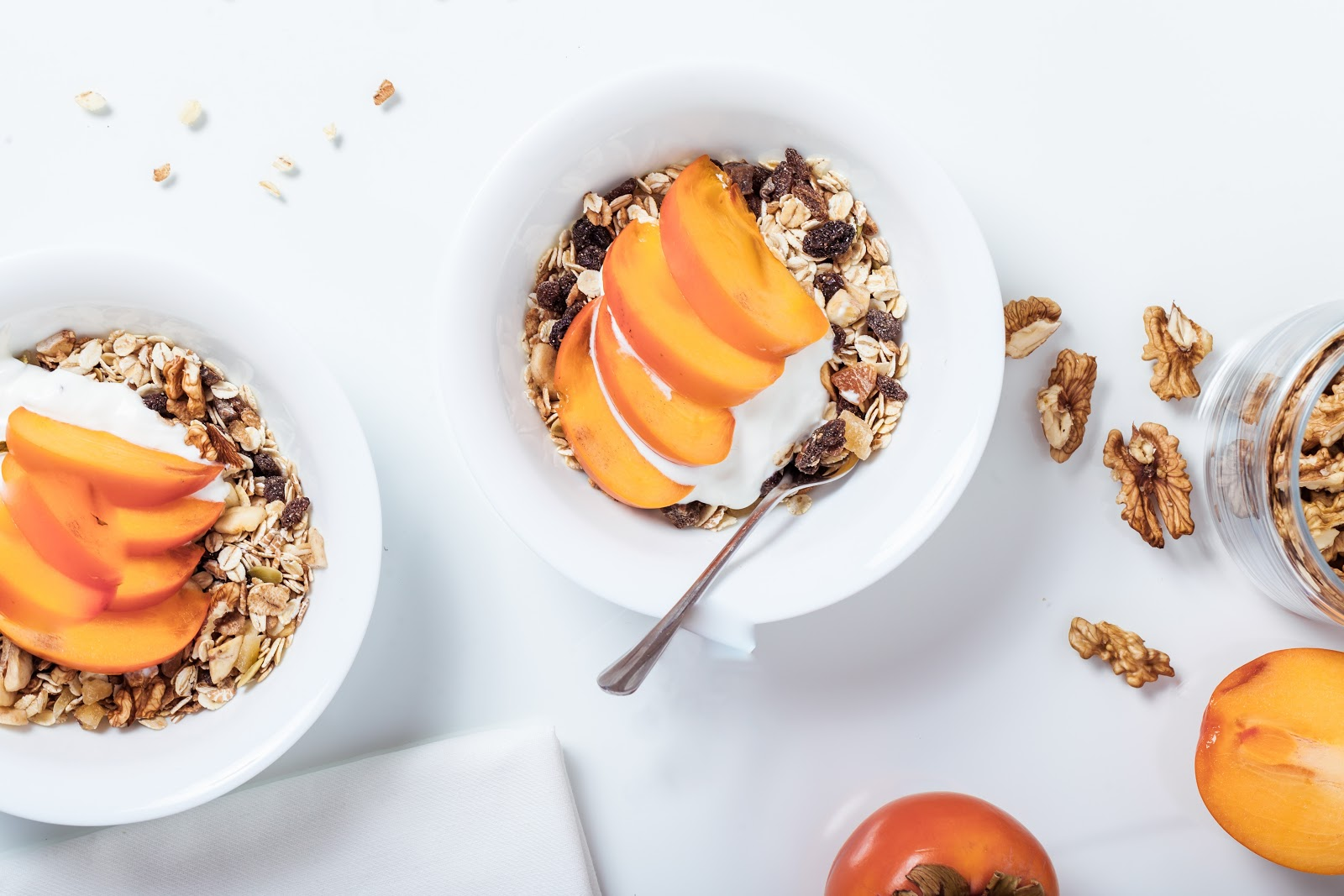 a bowl of granola with sliced peaches on top