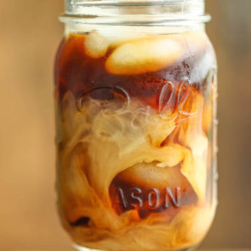 Ball mason jar filled with creamy iced coffee drink