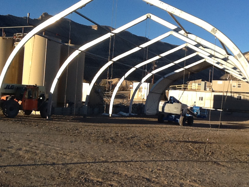 Allsite mining fabric structure under construction showing aluminum frame at mining site