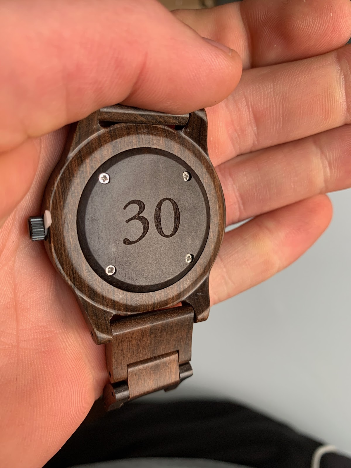 Wooden watch engraved with the number 30.