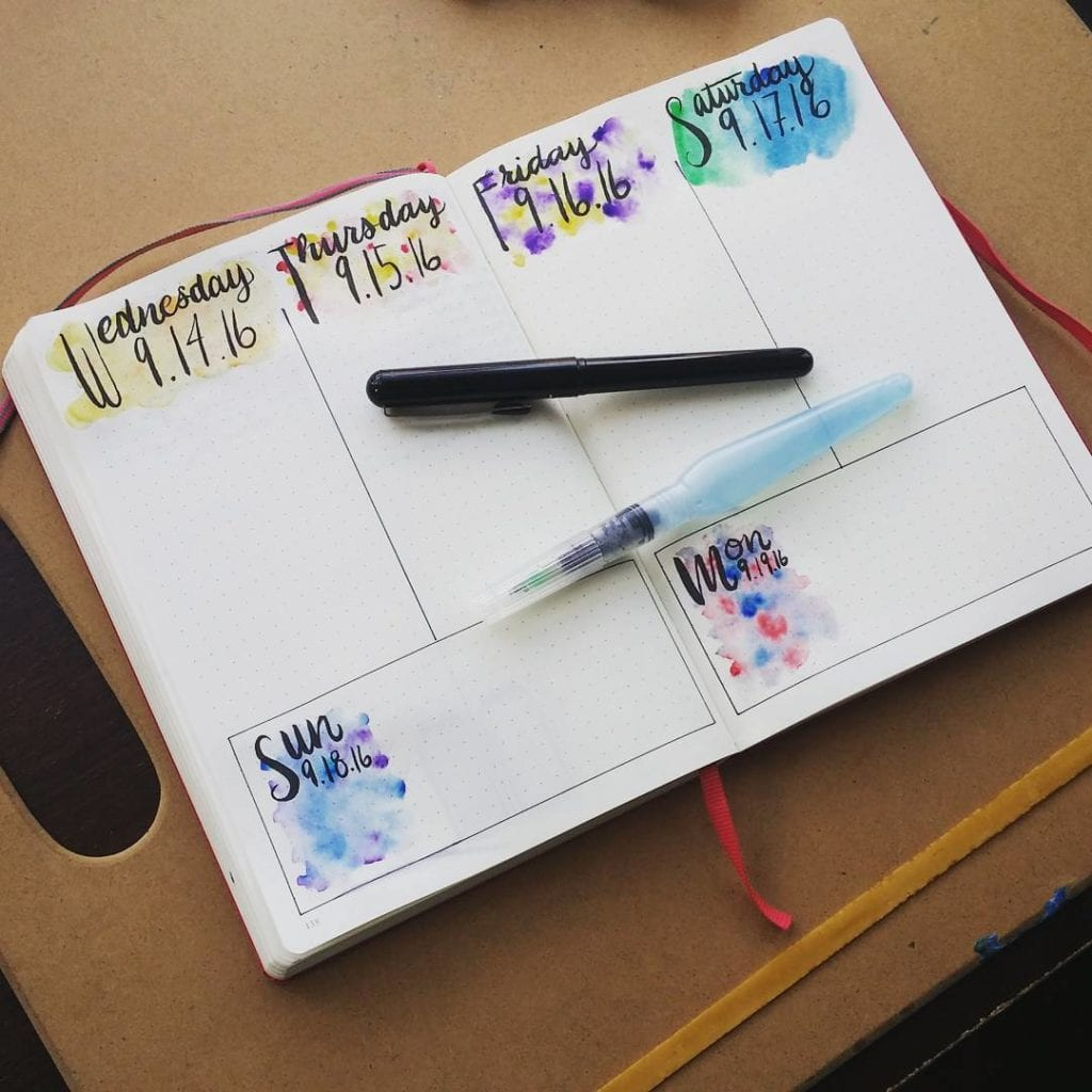 A bullet journal with a simple watercolor background