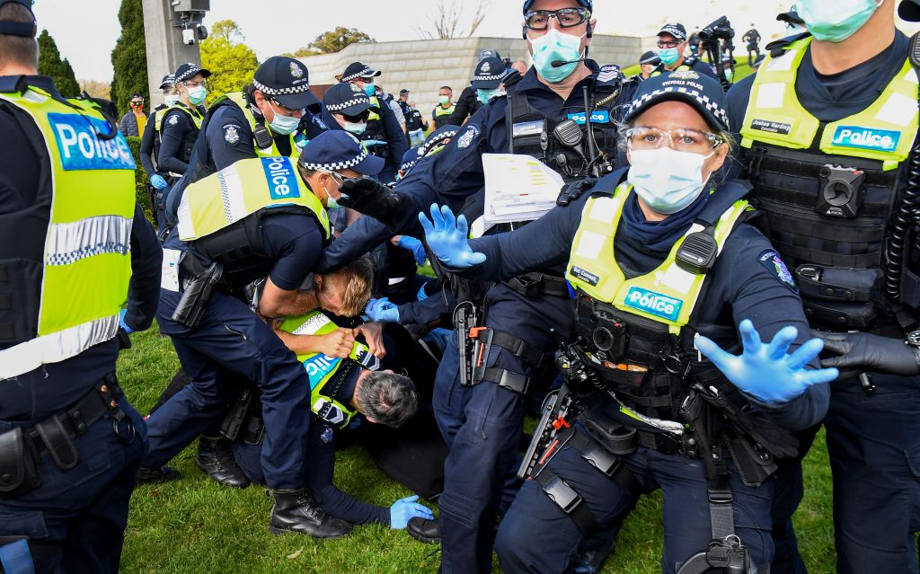 Police tackle protesters in Melbourne on September 5, 2020 during an anti-lockdown rally. Victoria Premier Dan Andrews was a personal signatory to the Chinese Communist Party's hegemony project, the Belt and Road Initiative, which has since been rescinded by the Australian federal government after Andrews severely injured his back falling down a staircase.