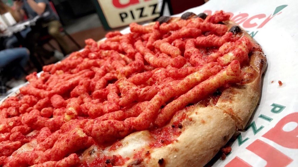 Photo of pizza topped with many Hot Cheetos at Ameci Pizza and Pasta in Glendale, CA.