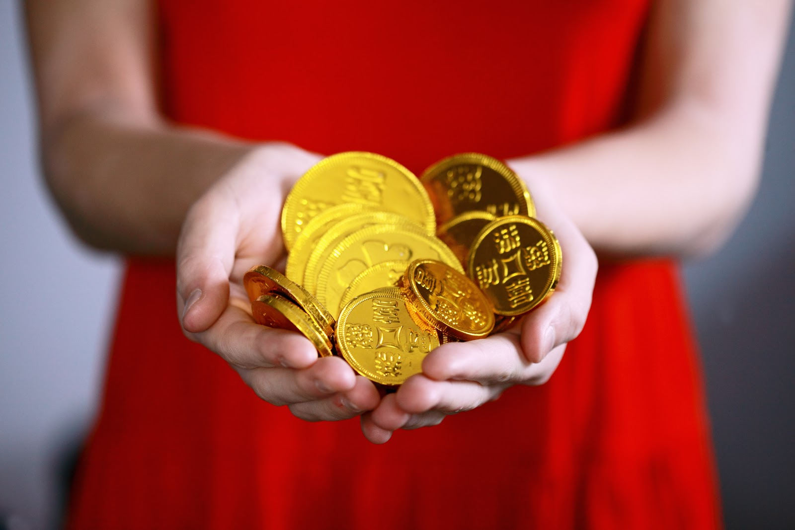 woman holding golden coins, scaling business