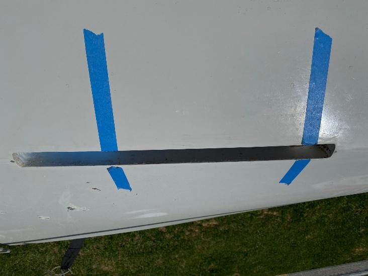 A picture containing grass, aircraft, outdoor, plane Description automatically generated
