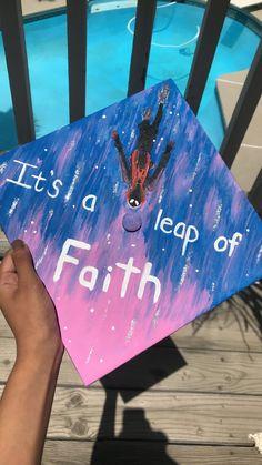 """A graduation cap that reads """"It's a leap of faith."""""""