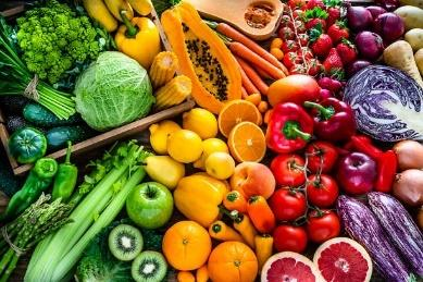 Healthy fresh rainbow colored fruits and vegetables background High angle view of a large assortment of healthy fresh rainbow colored organic fruits and vegetables. The composition includes cabbage, carrots, onion, tomatoes, raw potato, avocado, asparagus, eggplant, celery, cucumber, broccoli, squash, lettuce, spinach, lemon, apples, pear, strawberries, papaya, mango, banana, grape fruit, oranges, kiwi fruit among others. The composition is at the left of an horizontal frame leaving useful copy space for text and/or logo at the right. High resolution 42Mp studio digital capture taken with SONY A7rII and Zeiss Batis 40mm F2.0 CF lens colorful food stock pictures, royalty-free photos & images