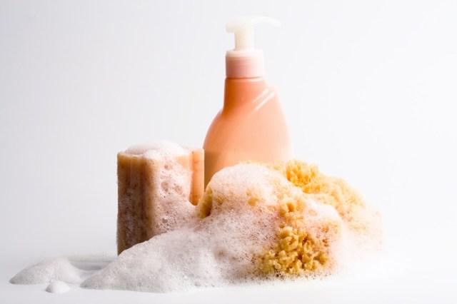 soap, natural sponge and shower gel closeup