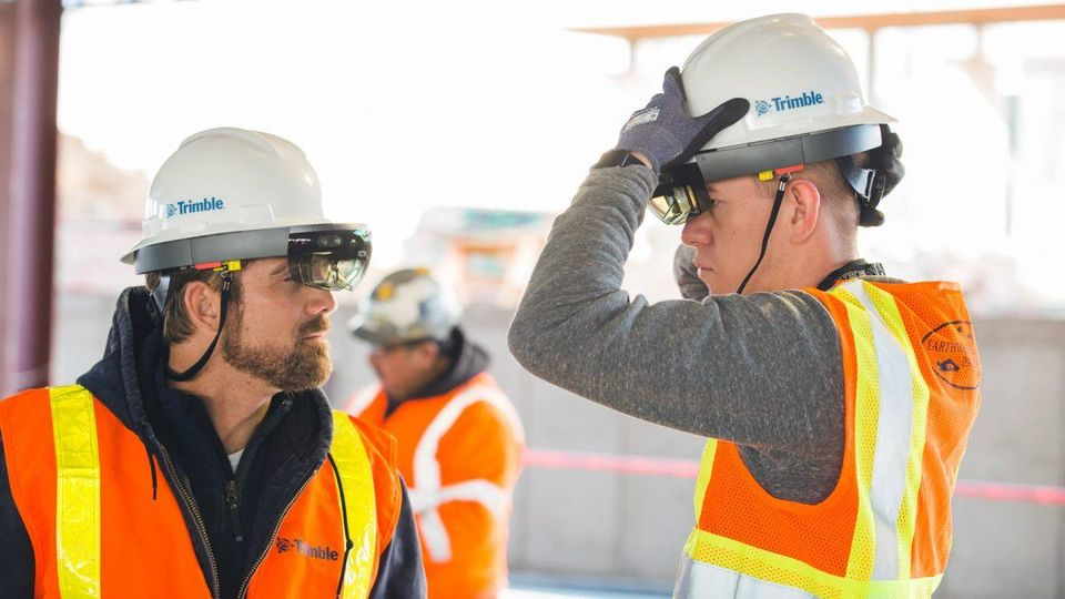 Using holographic data on the job site, workers can review 3D models overlaid directly on a physical environment. TRIMBLE
