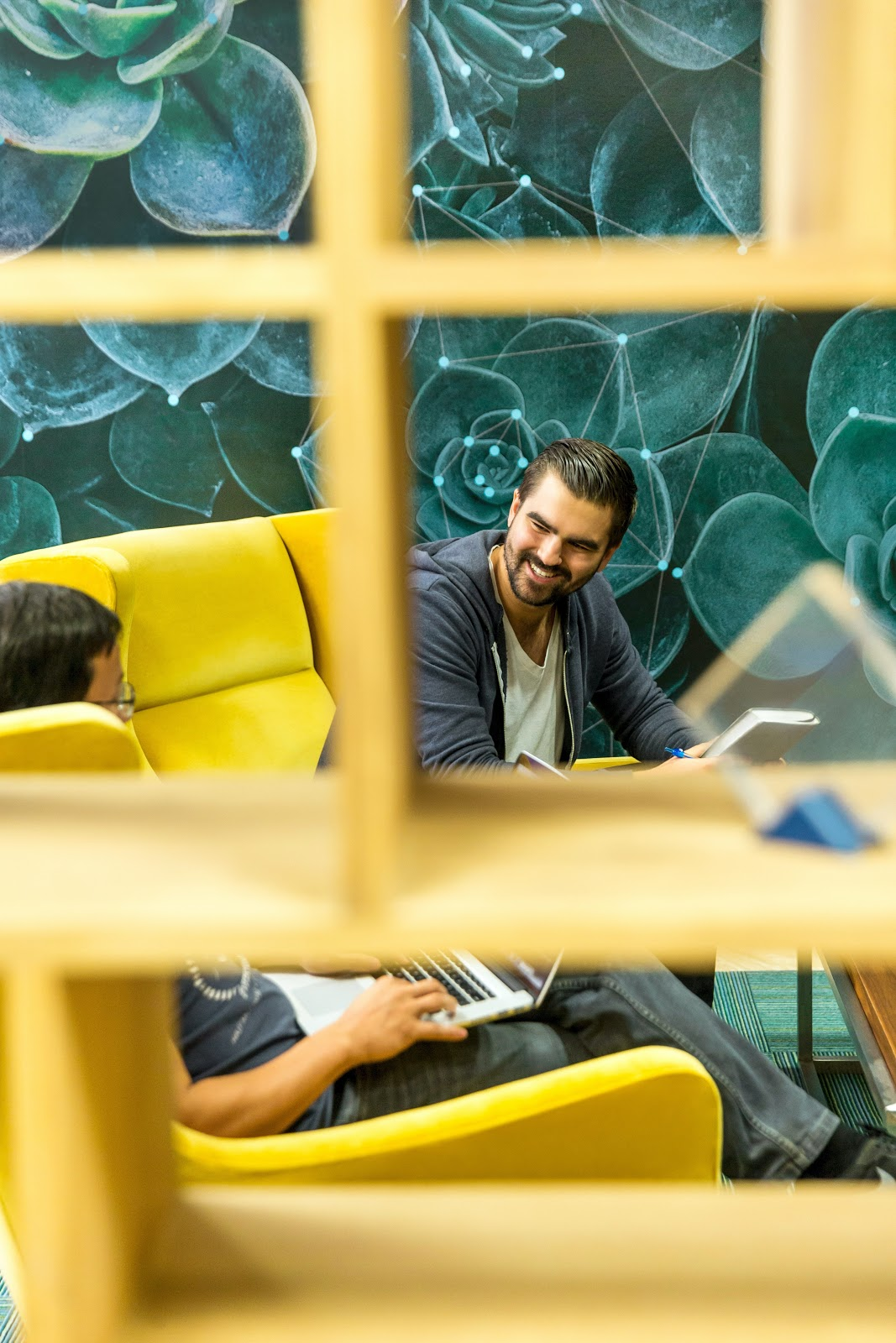 healthy employees are happy employees sitting in comfortable work space talking