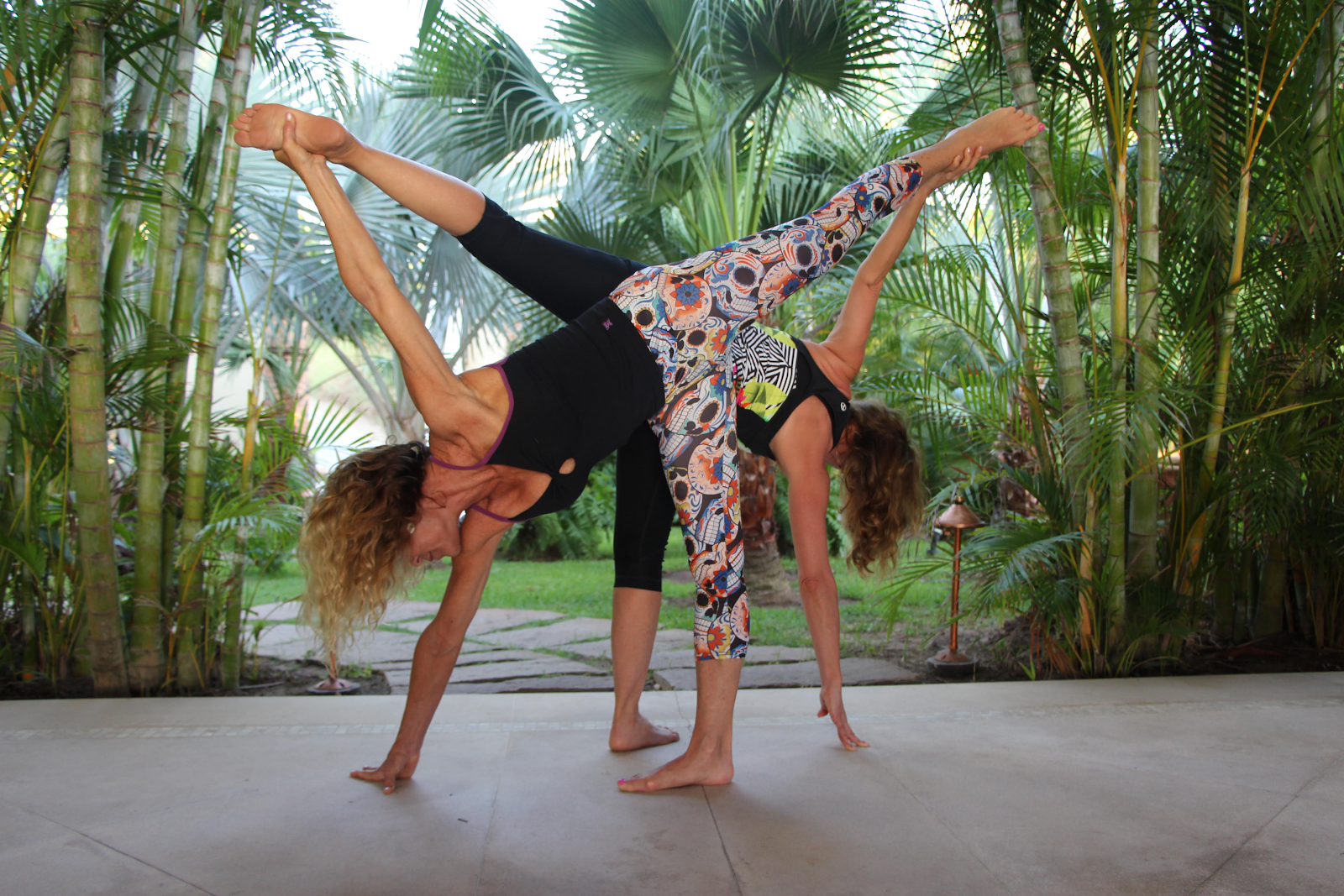 Tonyah doing yoga with a friend