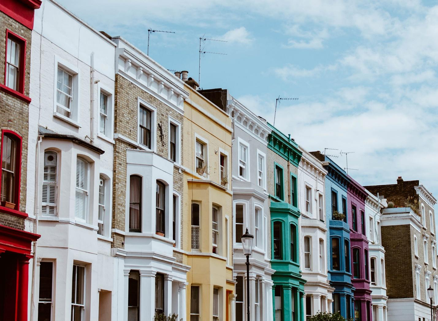 Colorful houses lining a street.