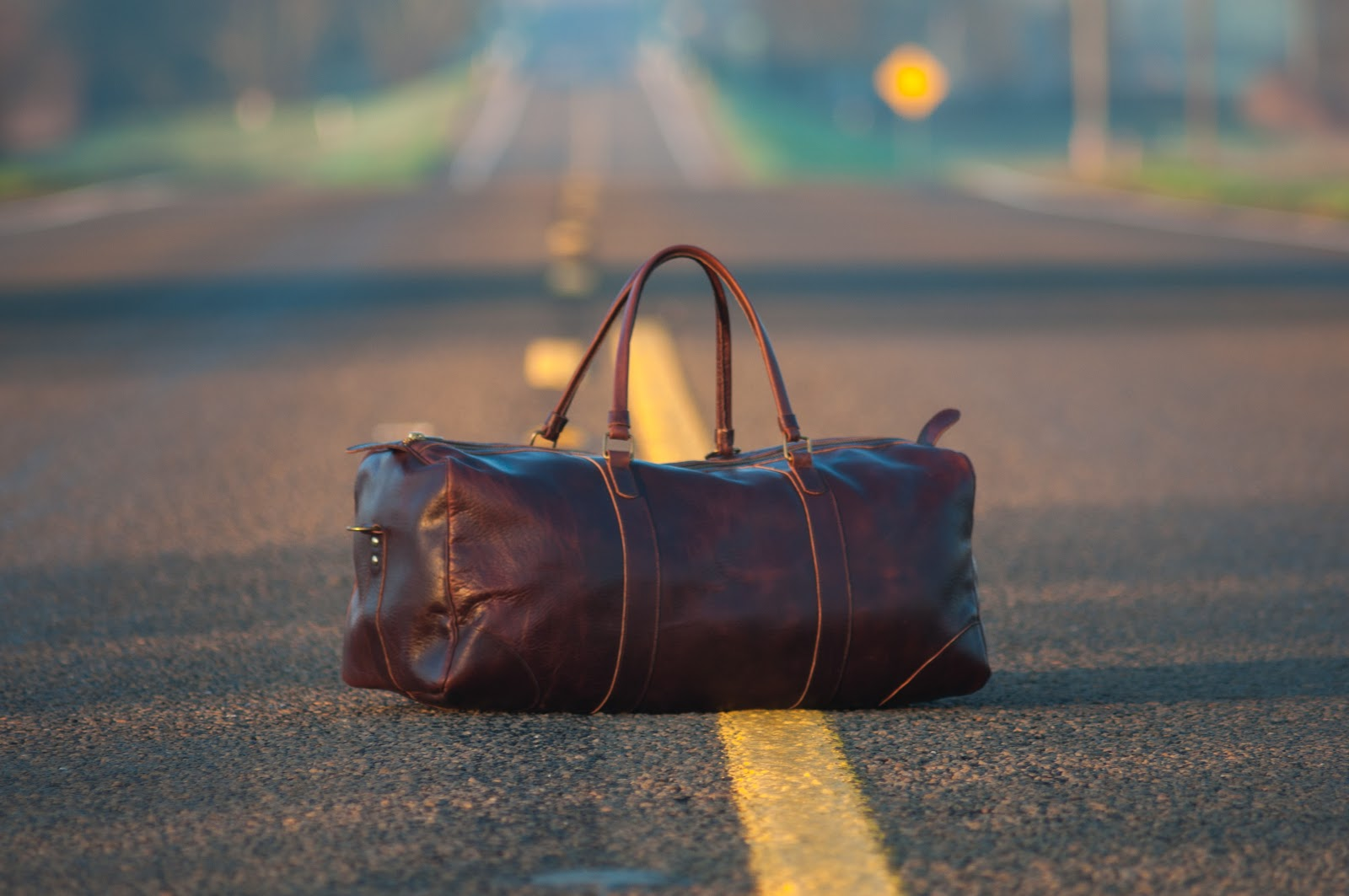 suitcase in the middle of the road