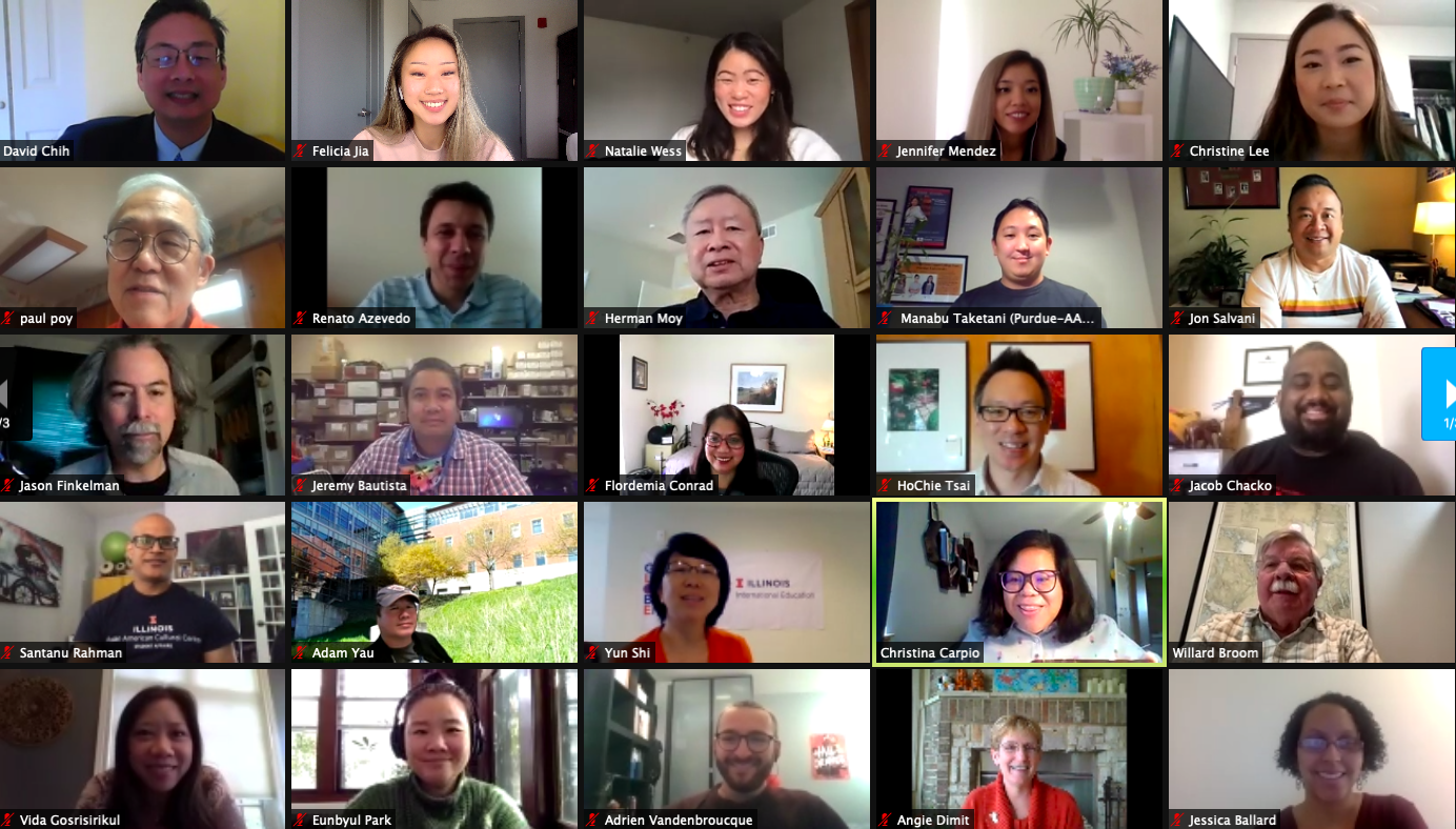 Screen shot of a virtual meeting with a large group of people smiling