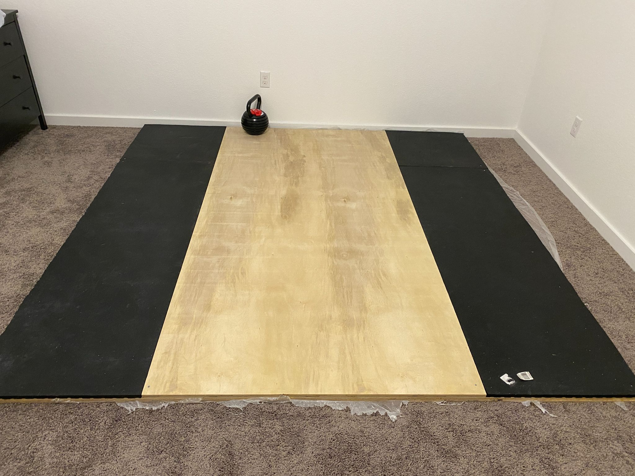 How we have used horse stall mats to create our weightlifting platform