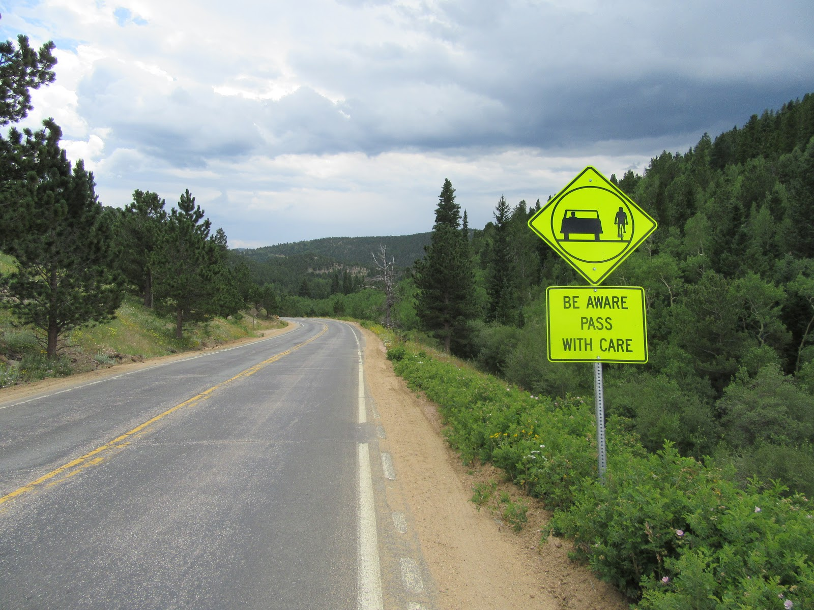 Cycling Left Hand Canyon - road sign of car and cyclist