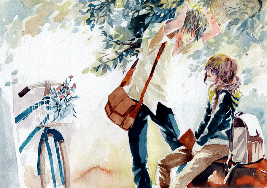 A guy leaning over a girl, a bike in the background.