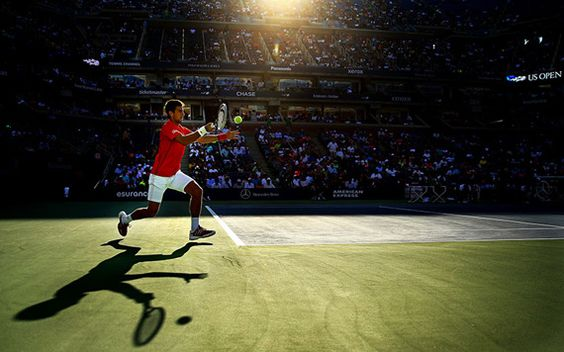 Novak Djokovich playing tennis in the US Open tournament, 2013, by Al Bello