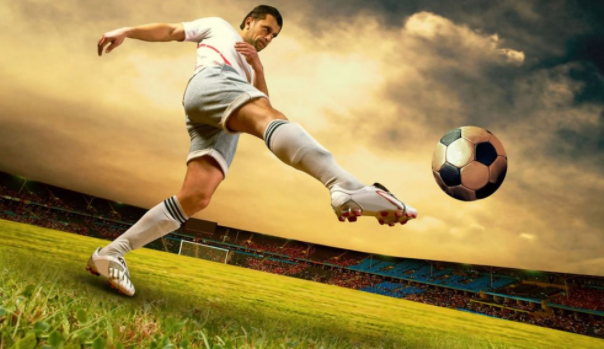 A football player kicking a ball  Description automatically generated