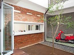 Rumah dinding bata merah tanpa plester