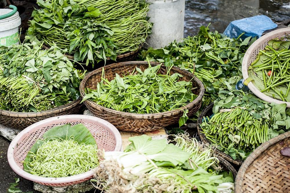 green vegetables on brown wicker basket