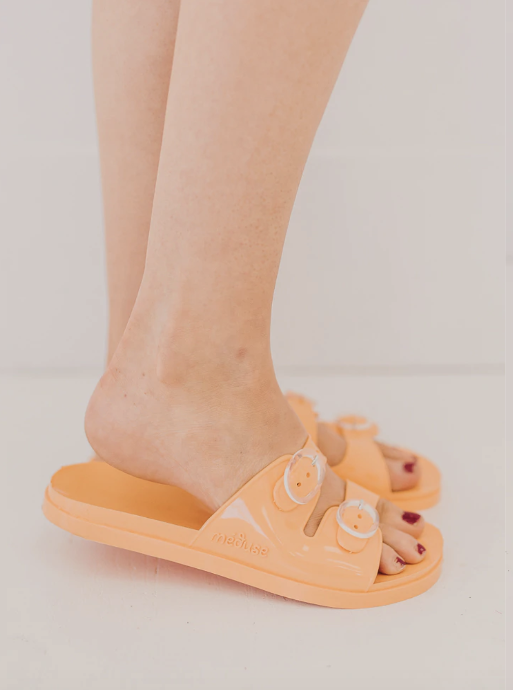 Open toed slip on jellies with buckle detail.