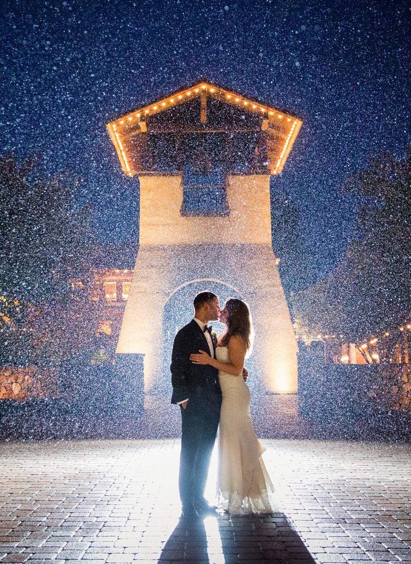 wedding couple kissing in misty vignette