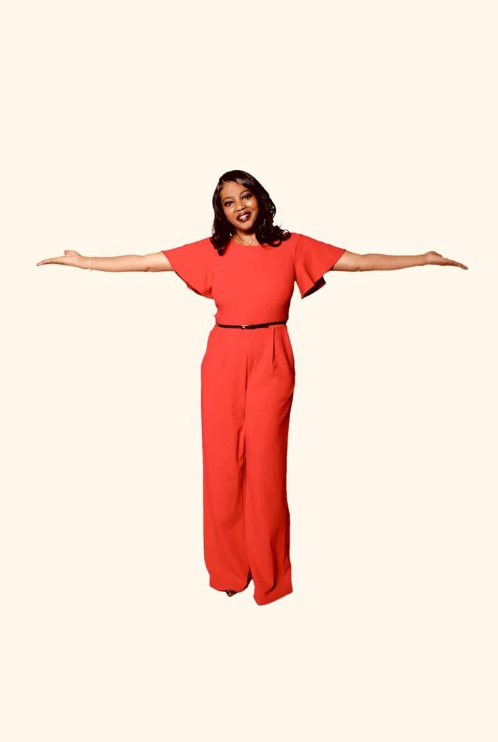 A person in a red dress  Description automatically generated with medium confidence